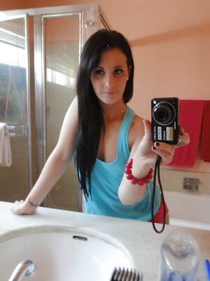 Brunette girl decides to take some spicy pics of herself in the bathroom