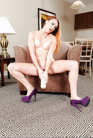 Pretty redhead smiles while stuffing tight cunny with some large sextoys
