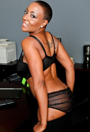 Short-haired Ebony Sexually available mom strips to lingerie and playfully pushes bra a tiny