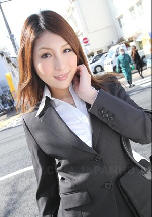 Nice-looking Japanese secretary seductively poses while going at her work