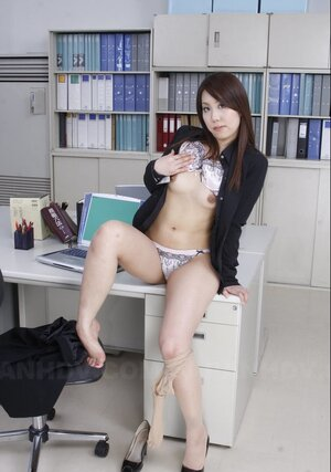 After work nice-looking Japanese secretary undresses in empty office