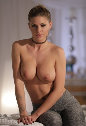 Classy blonde with round breasts unclothes while expecting her masseuse