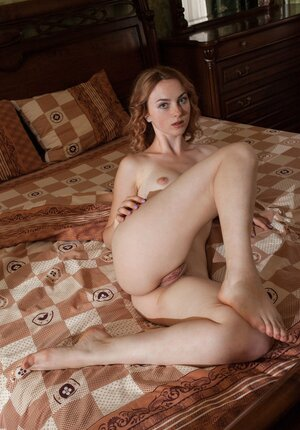 Hot young and fresh woman addicted to striptease and gets naked in her bedroom