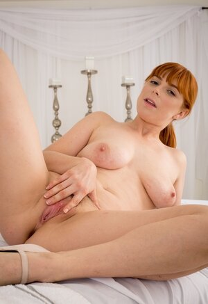 Natural ginger masseuse waits for the user stripping on the massage table