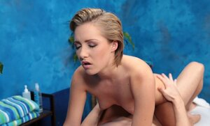Masseuse wears only panties giving customer a hint that she is ready for coition
