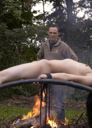 Creepy dude dominates over submissive brunette outdoors in various ways
