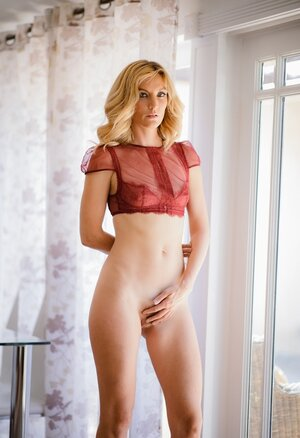 Skinny blonde Soccer mom stays naked by window and waits for girlfriend's arrival