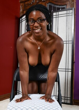 Black girl with huge butt cheeks smiles so modestly taking different XXX poses