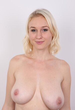 Blonde kitten has different-shaped jugs and besides red hair on pubis on XXX pics