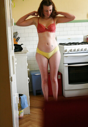 Whorey gets dressed in the kitchen being filmed on a hidden cam