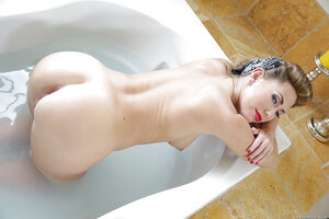 Sexy Soccer mom puts a bright lipstick on and gets in the bathtub in the naked