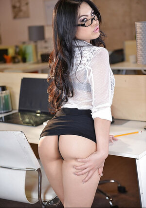 After work the Asiatic secretary with glasses exposes nude body in the office