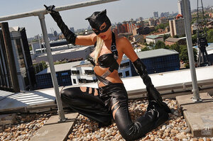 Porn pro dressed like a catwoman laps milk and undresses on the sunny roof