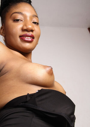 Ebony chick Maite with a big nose boasts about her tender pink twat on the sofa