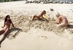 Group of immature sinful girls pose absolutely naked on the beach with no shame